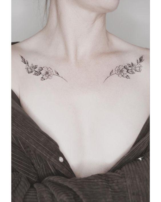 minimal omuz dövme modelleri siyah geri çiçek dövmesi