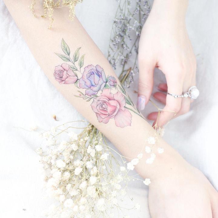 minmal cicek dovmesi minimal flower tattoo42