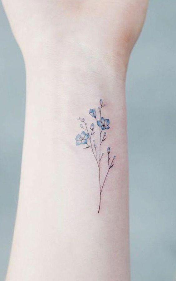 minmal cicek dovmesi minimal flower tattoo6